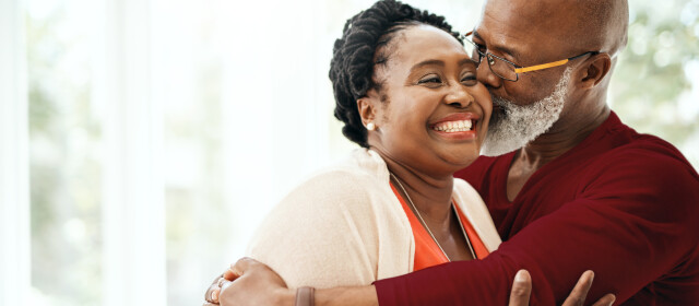 Shot of a mature man affectionately kissing his wife at home